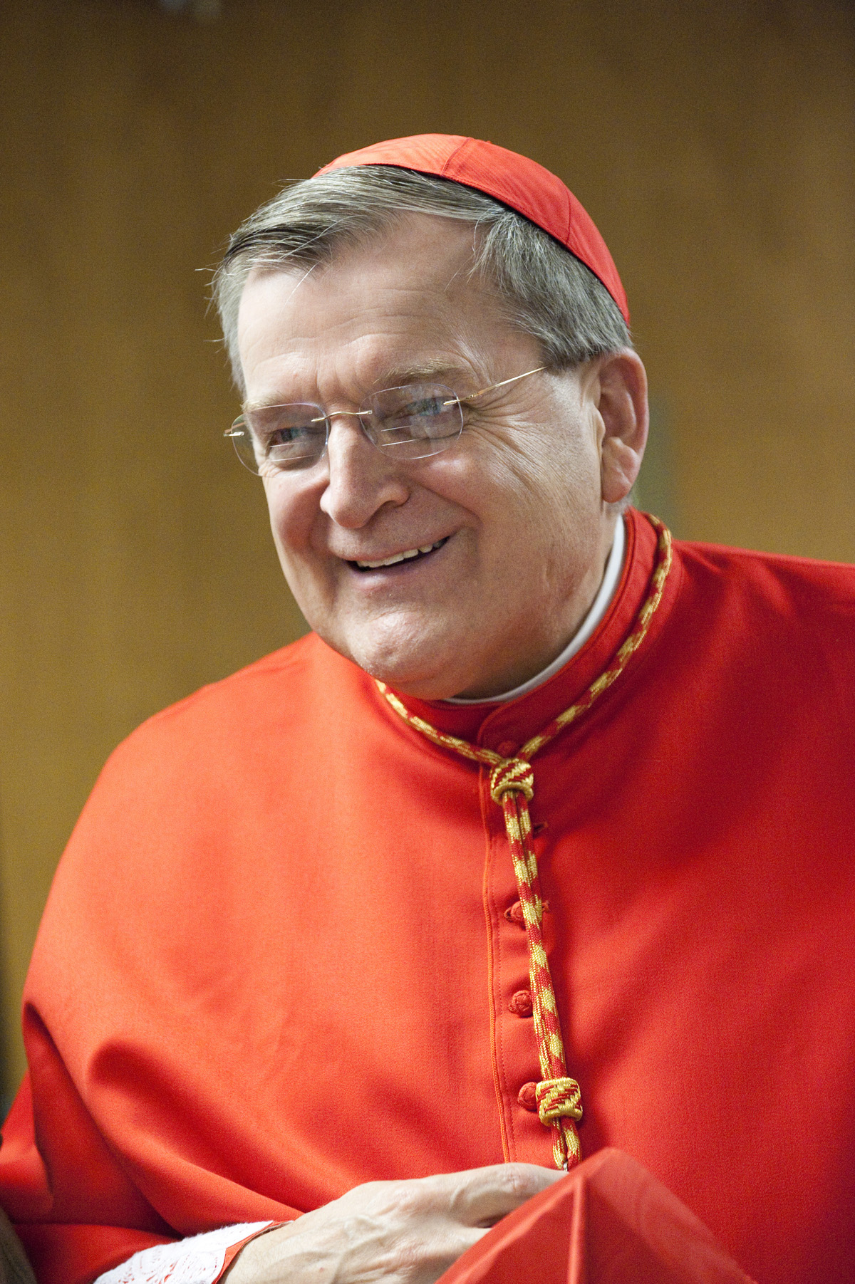 LISA JOHNSTON | lisa@aeternus.com  lisajohnston@archstl.org  His Eminence Raymond Cardinal Leo Burke | Prefect of the Apostolic Signatura | Archbishop Emeritus of St. Louis in front of the shrine to the Sacred Heart of Jesus in the Cathedral Basilica of S
